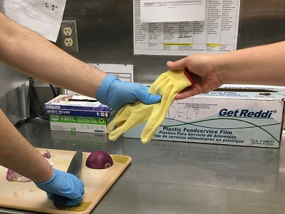 Handing someone a cut glove