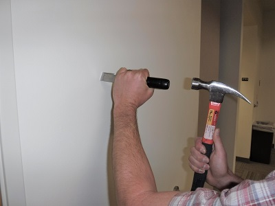Hammering into a wall